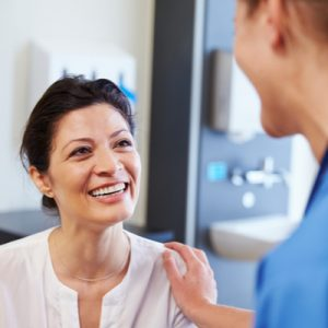 A patient smiles at a doctor.