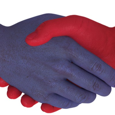 A handshake between a red hand and a blue hand, indicating the bipartisanism of the Bipartisan Budget Act.