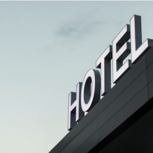 """A sign reading """"hotel"""", a possible temporary shelter for homeless populations during the COVID-19 pandemic."""