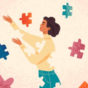 A brown-haired person in sweater and jeans, with puzzle pieces removed from her body and floating around her. The puzzle pieces are meant to be health services, which are scattered instead of integrated.