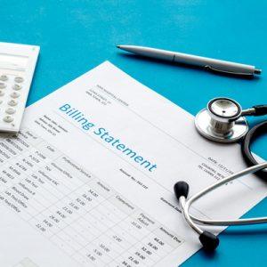 A hospital bill on a blue table.